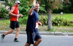 Coach Mike Gomez runs marathon to raise funds for senior's tuition