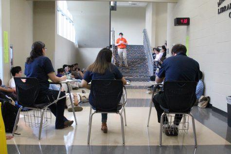 The judges, Ms. Molbert, Ms. Castillo, and Mr. Azano listen as Poetry Slam winner Grant Holmes reads his original poem.
